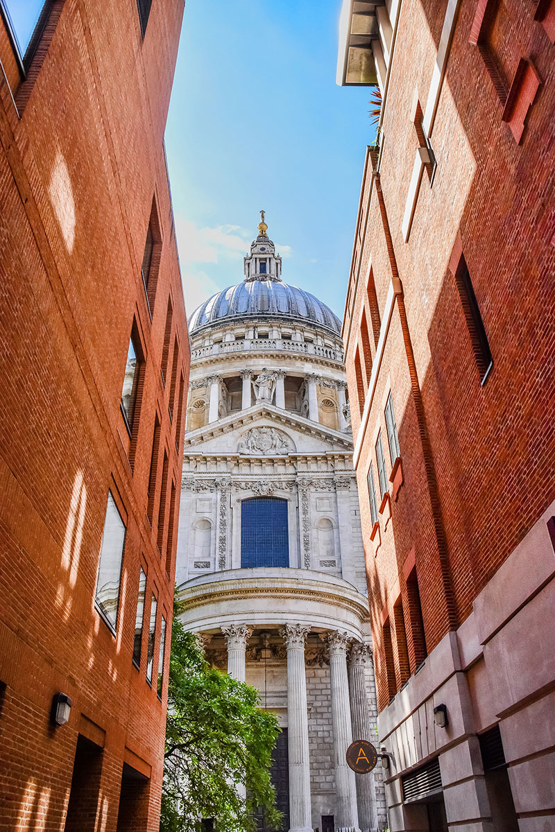 Boldness and true character of an evangelical masterpiece here st pauls cathedral appears to be sandwiched between two modern structures